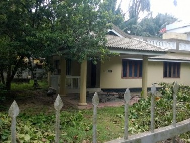12 Cent square land with 1700sqft house. Plot is 500m from PADINARE NADA OF GURUVAYUR TEMPLE.