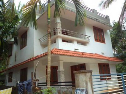 1400 Sqft 4 BHK House on 4 cents of land for sale at Karaparamba,Kozhikode.