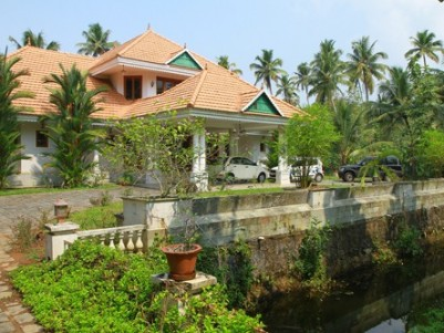12 Acre Land with 6000 Sqft Bungalow for sale at Kumarakom,Kottayam.