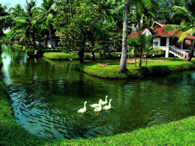 Luxury waterfront resort for sale at the famous backwaters of Kumarakom in Kerala