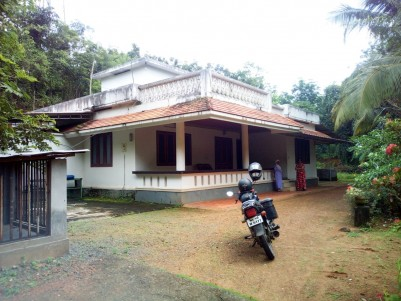34 cent Square land  with an old house for sale near Puthupally.Kottayam